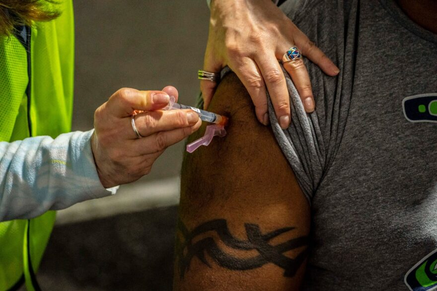 A patient with a traditional Fijian tattoo receives a COVID-19 vaccination in Federal Way, Washington. Swedish Medical Center held a mobile vaccination clinic at the Pacific Islander Community Association of Washington to serve racial and ethnic minority groups disproportionately affected by COVID-19.