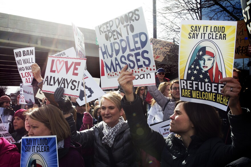 Protesters gathered in downtown Clayton in February 2017 to show soldarity with immigrants and refugees following the announcement of President Trump's executive orders.