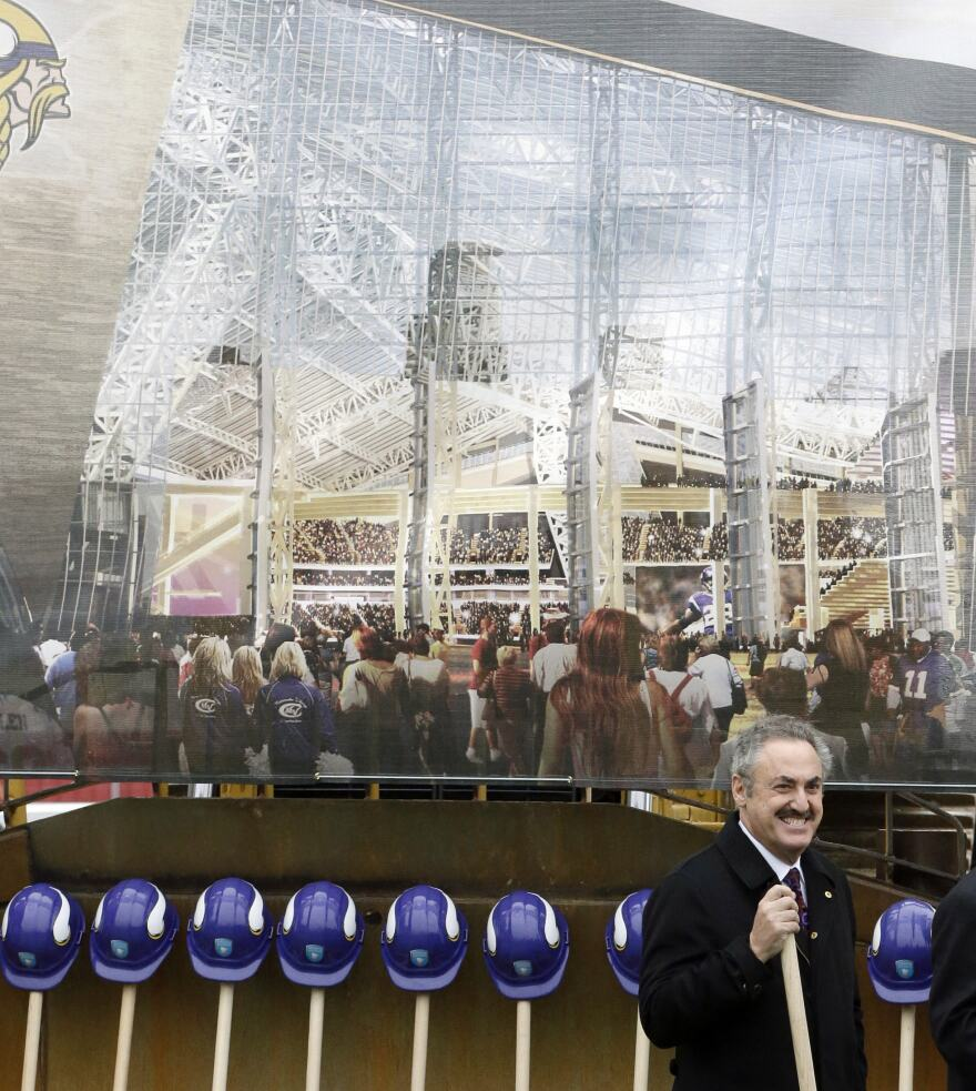A rendering of the new Minnesota Vikings stadium hangs behind team owner Zygi Wilf at groundbreaking ceremonies for the new stadium on Dec. 3, 2013, in Minneapolis.