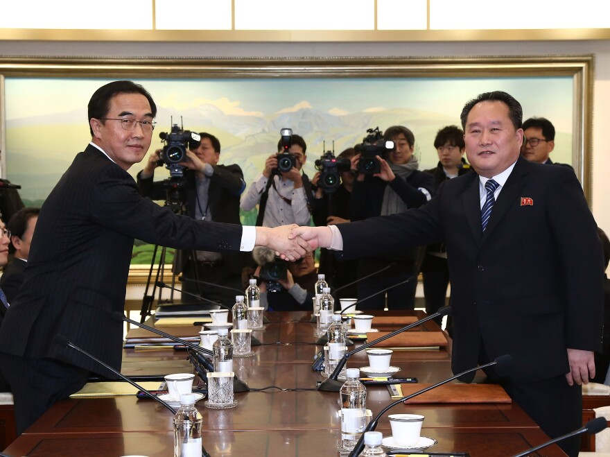 South Korean Unification Minister Cho Myoung-gyon, left, shakes hands with the head of North Korean delegation Ri Son-Gwon before their meeting at the Panmunjom in the Demilitarized Zone on Tuesday in Panmunjom, South Korea.