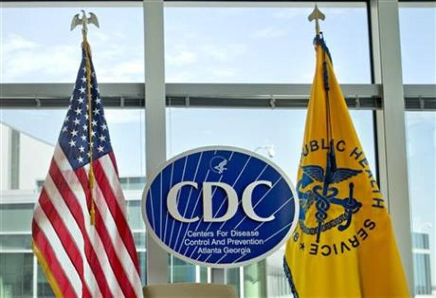The Centers for Disease Control and Prevention sign at the agency's federal headquarters in Atlanta. A new government report on health insurance has implications for the presidential campaign.