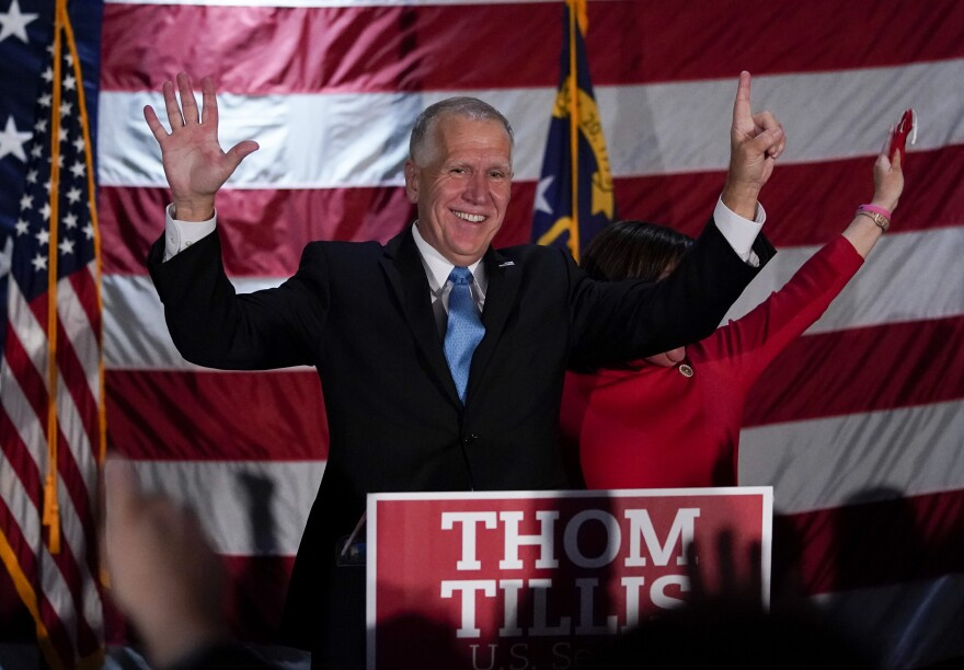Sen. Thom Tillis, R-N.C., celebrates at a election night rally in Mooresville, N.C., but it took several days in the tight race before Democrat Cal Cunningham conceded. The Associated Press has not yet called the race.