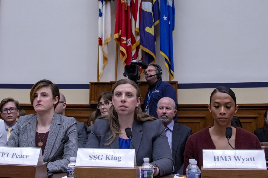 Army Capt. Jennifer Peace, Army Staff Sgt. Patricia King (center) and Navy Petty Officer 3rd Class Akira Wyatt attend a hearing on Transgender Service Policy on Capitol Hill in 2019. King and other trans troops have long fought for the right to serve openly prior to Trump's ban, and she hopes there is more legislation to follow Biden's repeal to ensure something like that does not happen again.