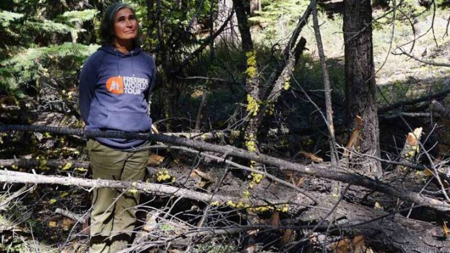 Patricia Maloney next to a dead sugar pine on Lake Tahoe.