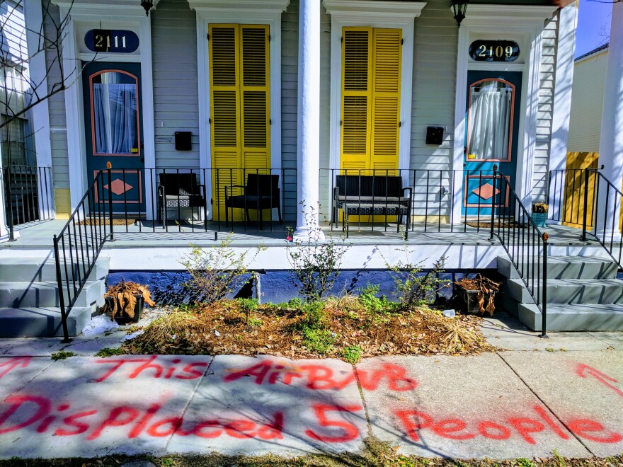 April Leigh spray-painted a message for tourists renting the New Orleans house in which she used to live after she was evicted from it and the new landlord converted it into a short-term rental property.