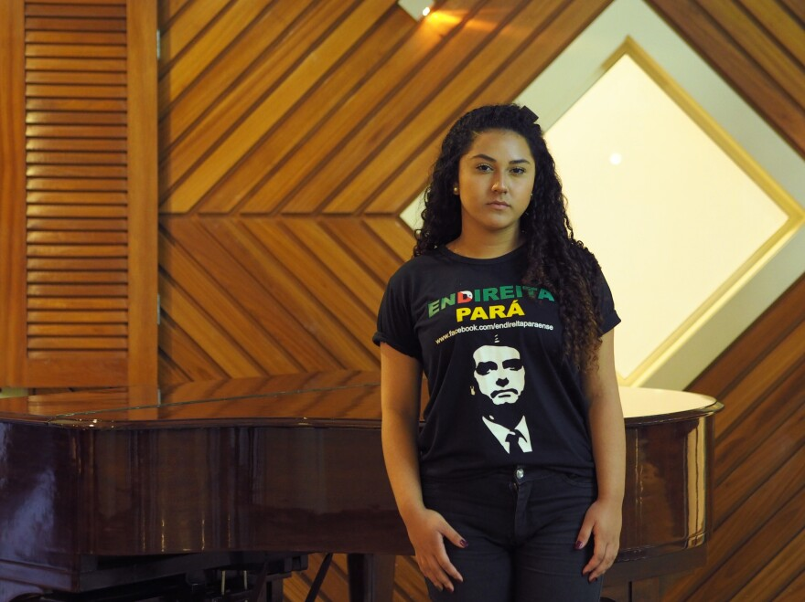 "High school student Victória Marques, 18, wears a shirt emblazoned with presidential candidate Jair Bolsonaro's face in the upscale Belém hotel where a local right-wing activist group meets. People ""treat us like radioactive objects,"" she says, ""like something that can't even be looked at. I've seen people crossing the street because I'm wearing a Bolsonaro T-shirt."""