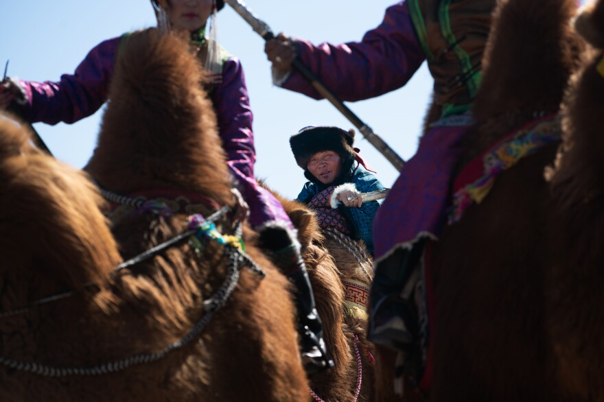 Enkhbaatar waits his turn to promenade in the camel beauty pageant. Lots of pictures are taken, which will allow future generations to have photographic proof of the herders' lifestyle.<strong></strong>