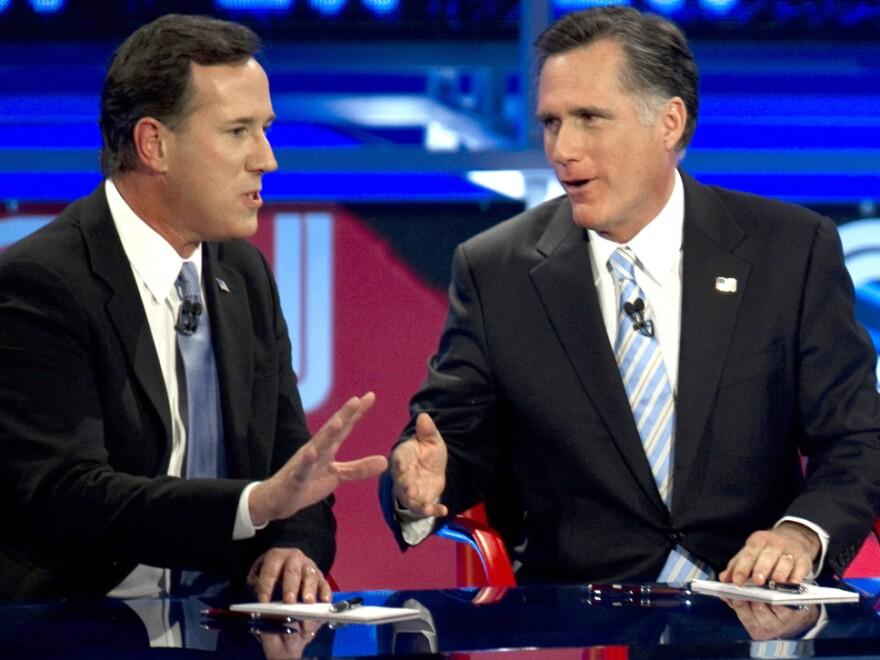 Back in their sparring days: Rick Santorum (left) and Mitt Romney during a Feb. 22, 2012, Republican presidential debate in Arizona.