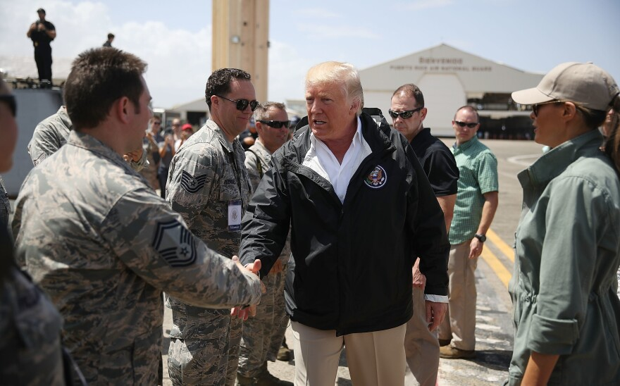 President Trump greets members of the U.S Air Force at the Muñiz Air National Guard Base in Carolina, Puerto Rico. Trump visited the island on Tuesday in the aftermath of Hurricane Maria.
