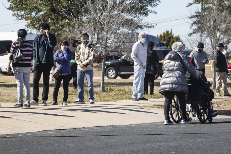 People wait in line for a COVID-19 vaccine from Austin Public Health on Jan. 13.