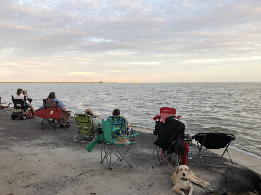 Spectators eye Kennedy Space Center from Titusville, awaiting the launch of 4 astronauts on SpaceX's Crew Dragon vehicle. Photo: Nelly Ontiveros, WMFE