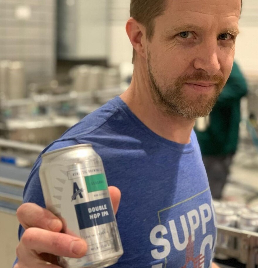 John Walker, Athletic Brewing Co.'s head brewer and co-founder, holds a can of nonalcoholic limited-edition Double Hop IPA, which sold out in 32 seconds after it was released online last week.