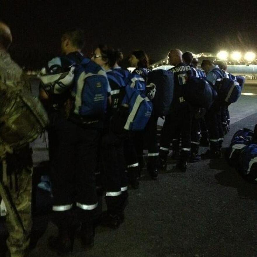 """NPR's Jason Beaubien, who is on assignment in the Philippines, posted this photo on Thursday. He writes that he was """"waiting with a French search and rescue team to board a night flight"""" on a military plane from Manila to the devastated city of Tacloban."""