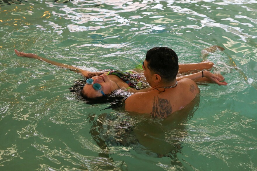 Agustin, Lola's father, teaches Lola how to float on her back at a hotel swimming pool on April 9, 2017. After four months of experimental chemo, Lola met her breaking point and ended the medical trial — a decision based on her quality of life. Revitalized, Lola gained the energy to enjoy her favorite activities again.