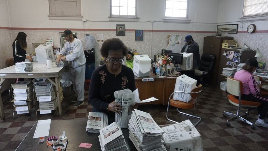 Leslie Terry (center) and the rest of the Roanoke Tribune team prepare the week's newspapers to be mailed to readers.