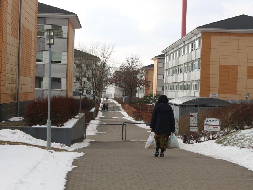 "A woman walks in Skovparken, an officially designated ""ghetto"" in the Danish city of Kolding."