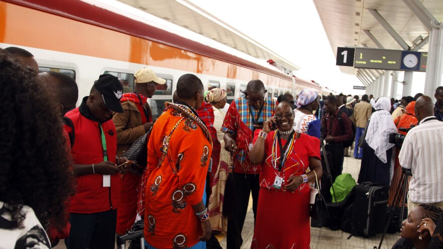 Kenyans wait to board a train in the port city of Mombasa on Wednesday. The country's new Mombasa-Nairobi rail line was financed by China and built by a Chinese company.