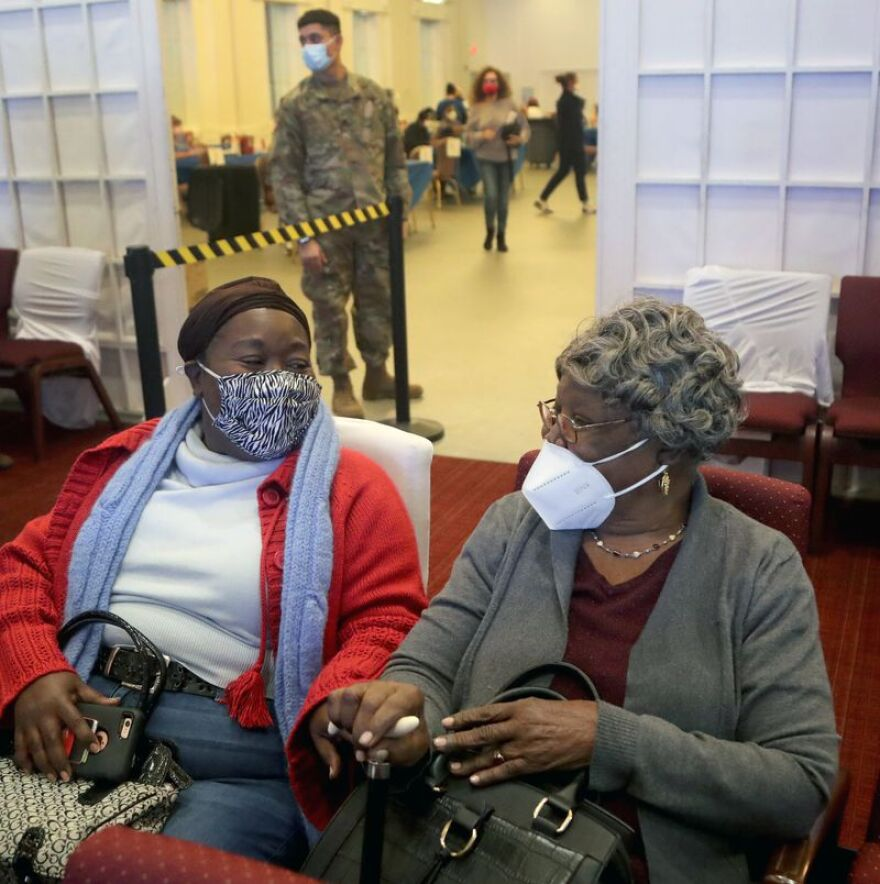 Ketley Joachim sits with her mom, Suzanne Noel, 97 from North Miami Beach after she received her vaccine during an interfaith COVID-19 vaccination drive at the Aventura Turnberry Jewish Center in Aventura Florida hosted in partnership with a mosque and Black churches on Feb. 4.