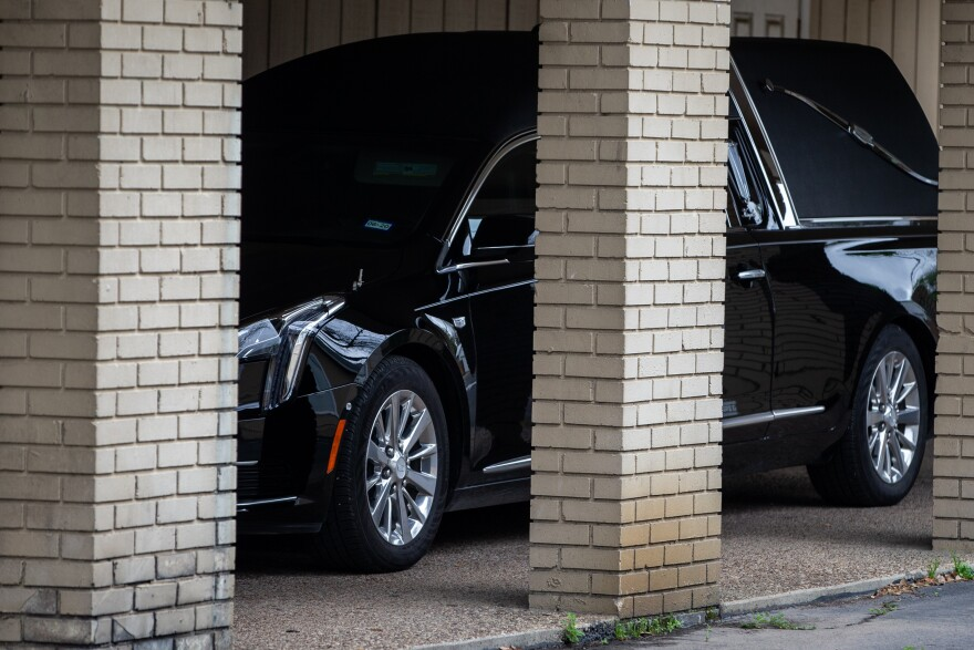 A hearse is parked outside Mission Funeral Home. Funeral homes in Austin must comply with local and statewide orders that limit how many people can gather during the coronavirus pandemic.