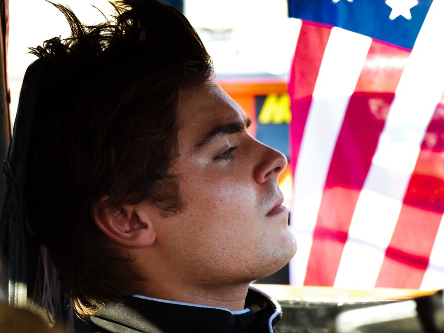 """In Ramin Bahrani's <em>At Any Price, </em>Zac Efron stars as a teen rebelling against his family and dreaming of becoming a professional race car driver. Sound like a generic summer pic? Critic David Edelstein says the film has """"a hell of a sting in its tail."""""""