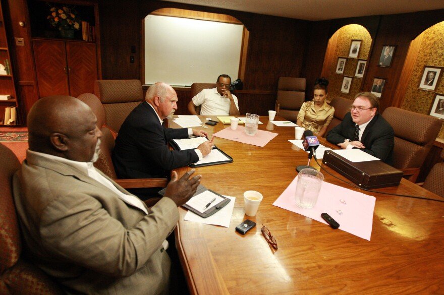 NAACP leaders from the Casper, Wyo., branch speak with members of the KKK at a heavily guarded meeting this past week.