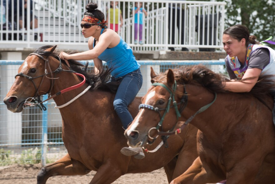 Photo of two riders in women's race.