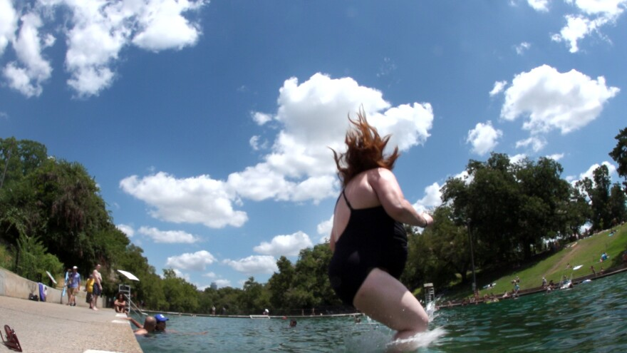 Susan Somers-Willett jumps into the deep end at Barton Springs Pool.