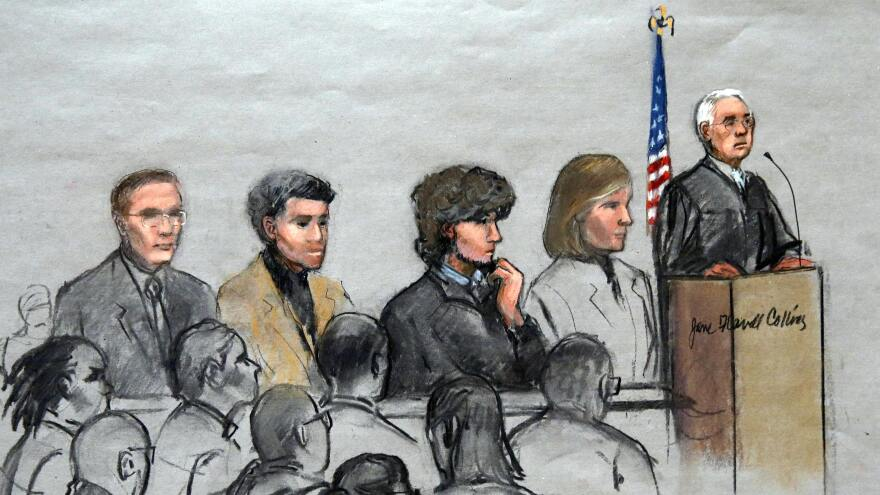 In this courtroom sketch, Boston Marathon bombing suspect Dzhokhar Tsarnaev (third from right) is depicted with his lawyers and U.S. District Judge George O'Toole Jr. (right) as O'Toole addresses a pool of potential jurors in a jury assembly room at the federal courthouse in January. The jury started deliberating Phase 1 of the trial on Tuesday.