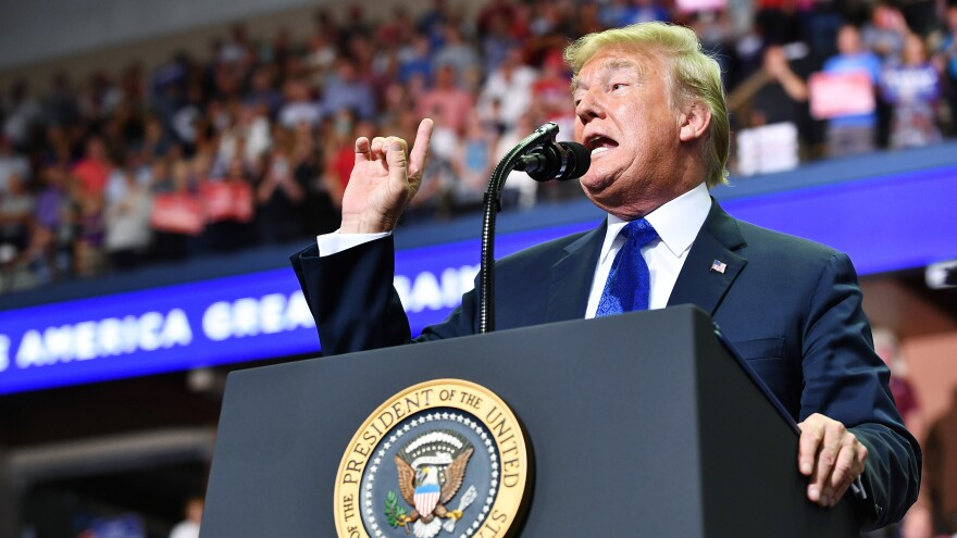 """President Trump speaks during a """"Make America Great Again"""" rally at Landers Center in Southaven, Miss., on Tuesday night."""