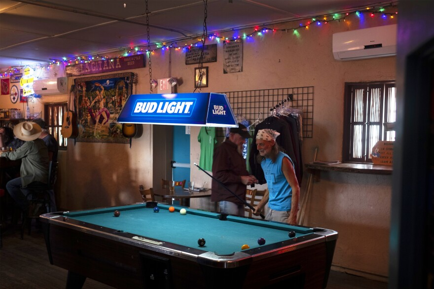 Patrons play pool at La Gitana Cantina, the one bar and restaurant in Arivaca.