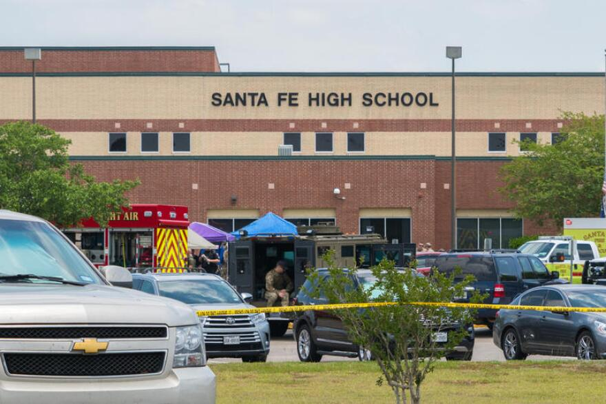 Law enforcement officials respond to the scene of a shooting at Santa Fe High School on May 18.
