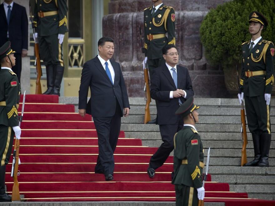 Chinese President Xi Jinping, center, arrives for a welcome ceremony for Tajikistan's President Emomali Rahmon in Beijing on Thursday. State media announced a key Chinese Communist Party meeting held once every five years will start on Oct. 18.