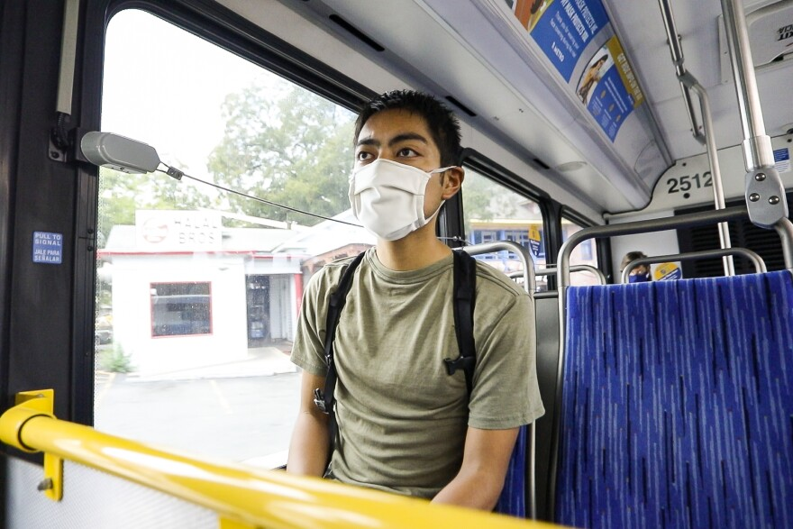 Graduate student Ryan Natividad rides a Capital Metro bus from his apartment in Hyde Park to the UT Austin campus.