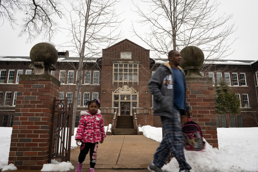 A child and an adult leave Farragut Elementary School in St. Louis's Greater Ville neighborhood in Jan. 9, 2019.