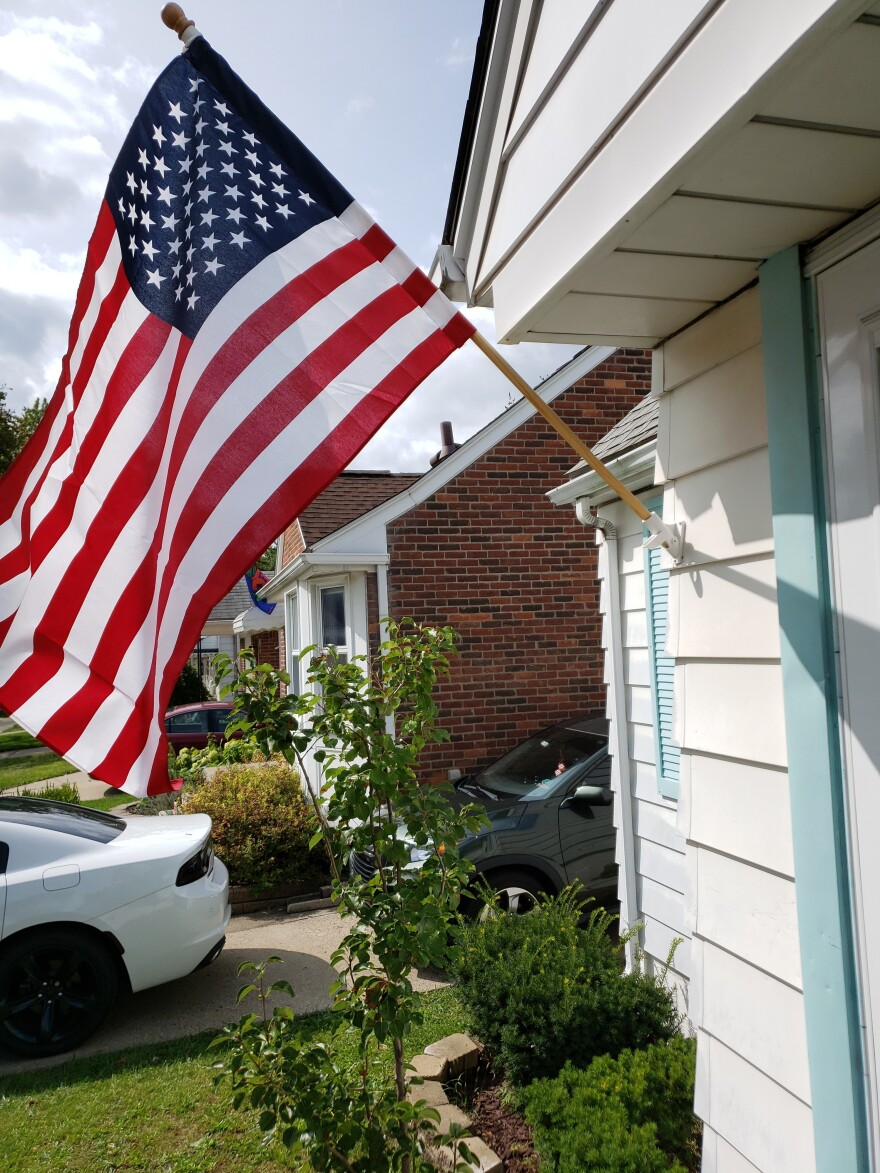 An Vu, the son of Vietnamese immigrants, sent NPR a photo of the U.S. flag he flies next to his garage. He says he misses the time after the Sept. 11 attacks when the country felt more unified.