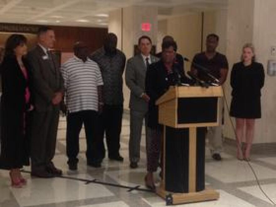 Rep. Kim Daniels (D-Jacksonville)[at the podium] and Rep. Cord Byrd (R-Neptune Beach)[behind Daniels] are sponsoring a bill to allow judges to decide whether to restore the rights of former felons.
