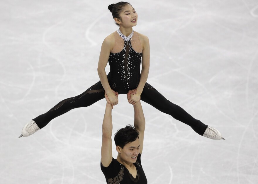 North Korea's Kim Ju Sik lifts Ryom Tae Ok during the pairs free skate final at Gangneung Ice Arena. The pair scored a personal best of 193.63 and finished 13th in their Olympic debut.