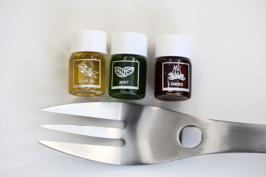"""The """"Aroma R-evolution"""" kit comes with four forks and 21 vials full of aromas like olive oil, mint and smoke. You drop a dab of scented liquid onto the base of the fork, and the smell is supposed to subtly flavor the food you eat while using the utensil."""