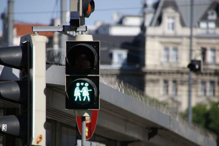A crosswalk signal in Vienna indicates pedestrians can now cross.