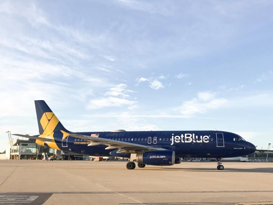 A JetBlue plane on a runway.