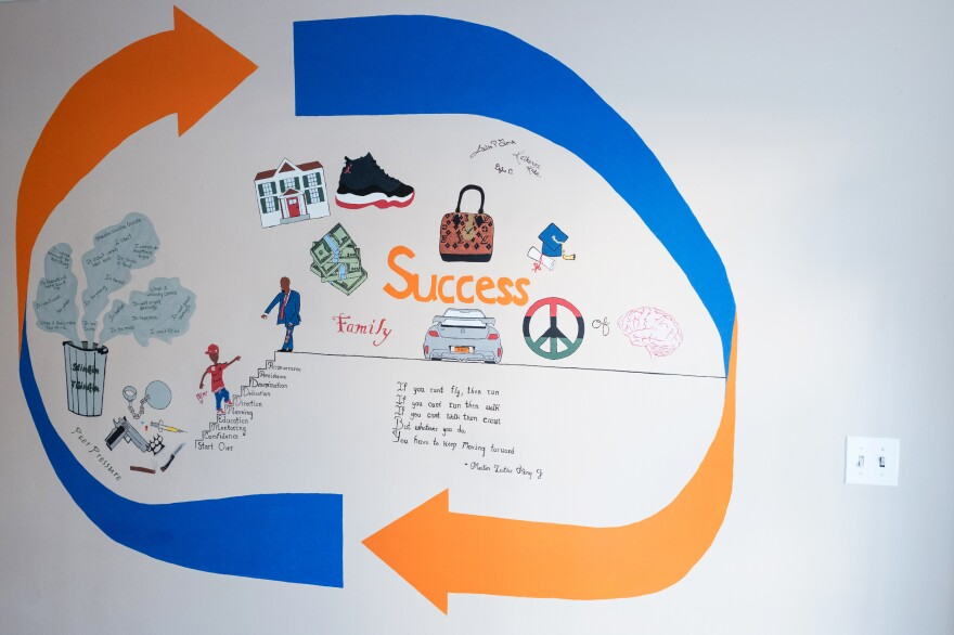 A mural at the Albany Youth Opportunity Office created by a former gang member shows paths to success.