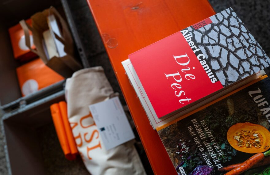 """French writer Albert Camus's book """"The Plague"""" (Die Pest, La Peste) is put out for delivery at the Uslar & Rai Bookshop in Berlin's Prenzlauer Berg district on March 31, 2020, amid a new coronavirus COVID-19 pandemic. (JOHN MACDOUGALL/AFP via Getty Images)"""