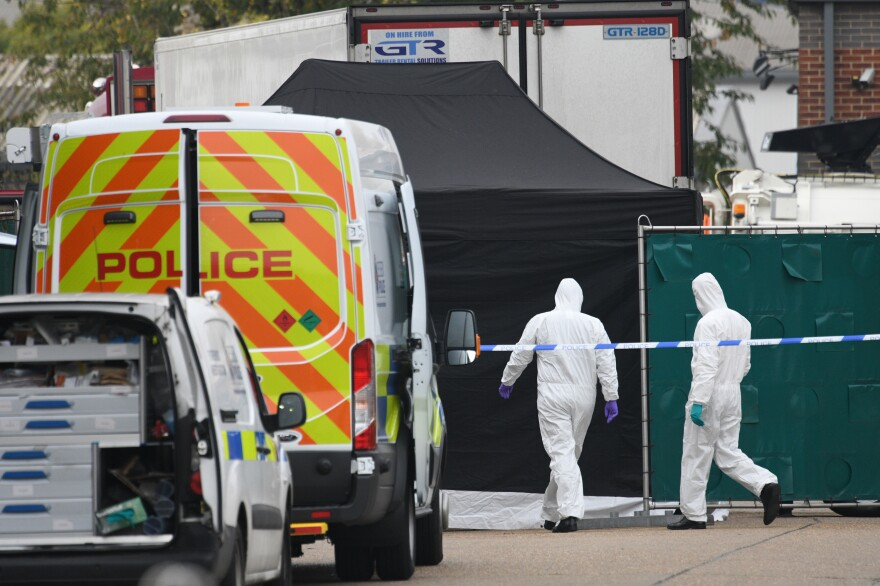 A police forensic investigation team walks near the site where 39 bodies were discovered in the back of a truck on Wednesday in Waterglade Industrial Park in Grays, England. Police believe the truck is from Bulgaria, a member of the European Union, and that it entered the U.K. on Saturday at Holyhead.
