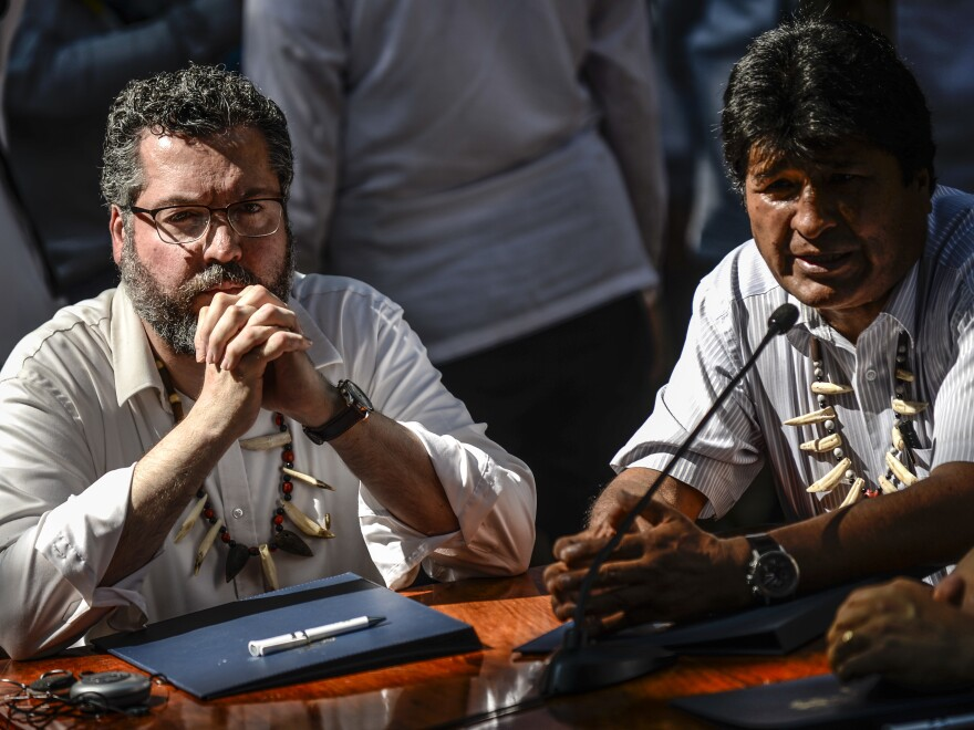 Bolivia's President Evo Morales (right) speaks next to Brazil's Foreign Minister Ernesto Araújo during a meeting of South American governments in Colombia, on Sept. 6. Seven countries agreed on measures to better protect the Amazon.