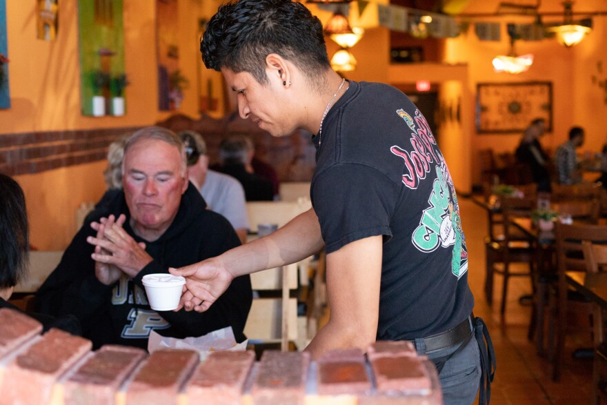 A waiter prepares to-go food for customers at Jose'peños Mexican restaurant in St. Charles County. 10/22/19