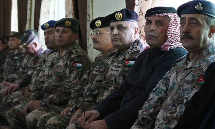 Saif al-Kaseasbeh (dressed in black), father of Jordanian pilot Muath al-Kaseasbeh, sits with senior officers of Jordan's military Wednesday at the headquarters of his family's clan in the city of Karak. Kaseasbeh is calling for revenge against ISIS for killing his son.