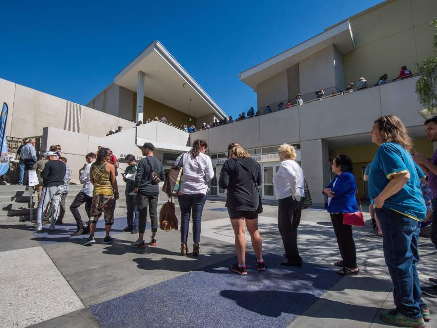 People wait to vote during the presidential primary at the Santa Monica Public Library in Santa Monica, Calif. on Super Tuesday, March 3.