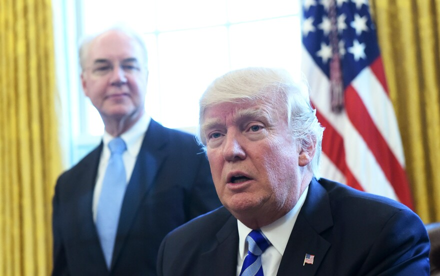 <em>The Washington Post</em> reports that President Trump, shown here with former Health and Human Services Secretary Tom Price, personally intervened to delay approval of Iowa's waiver application.