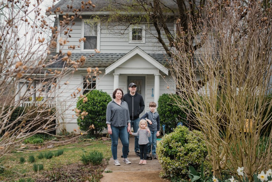 Maryanne Rawlings and her husband, Rob Rawlings, stand with their children, Jane, 3, and Robert, 7, at their home in Wyncote, Penn., on March 30. Both parents are teachers and have been working remotely. They are trying to balance teaching with helping Robert with schoolwork and keeping Jane entertained.