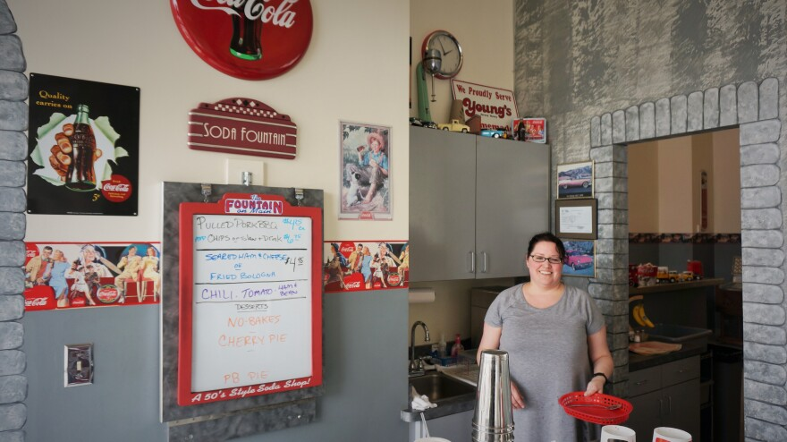 Hillary Pamer works at The Fountain on Main, a retro diner located across the street from EF Hutton headquarters.